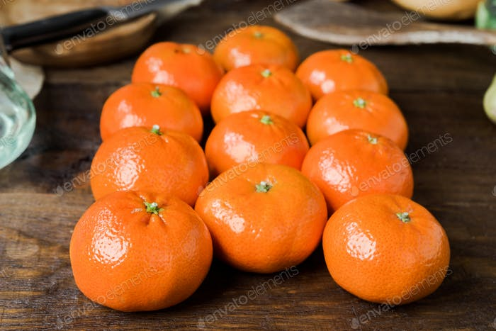 group of tangerines arranged in rows on classic rustic wood