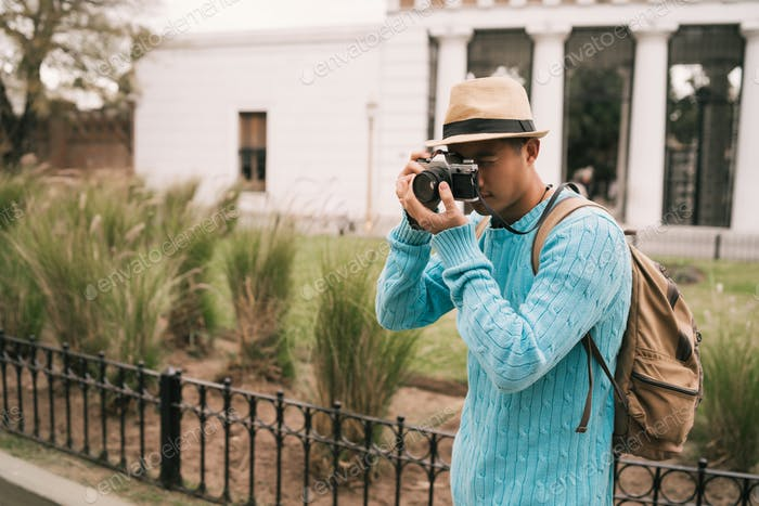 Asian tourist with a vintage camera.