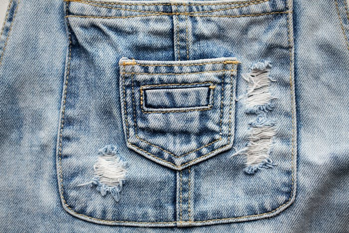 close up of denim clothes or jeans with pocket