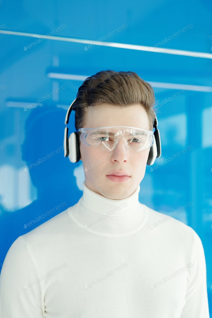 Young man in modern tech goggles