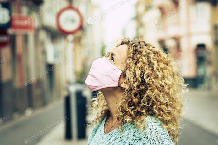 Adult woman wearing medical protective mask for coronavirus covid-19 virus emergency