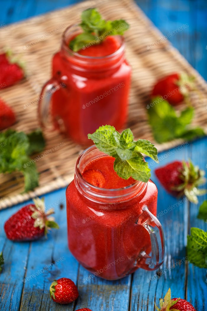 Jars of strawberry smoothie