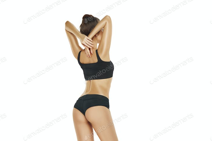 Fit, healthy and sporty girl in swimsuit. Sport, fitness, diet and healthcare concept.