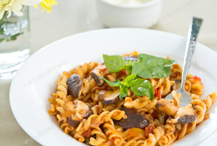 Fusili with mushroom in tomato sauce