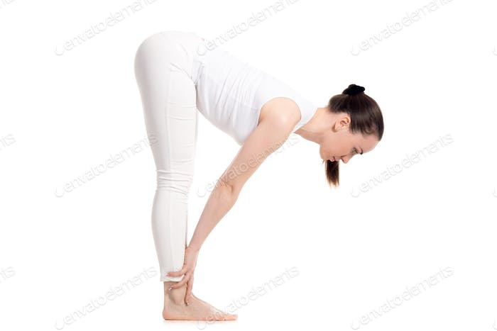 Yogi female standing in Half Forward Bend asana