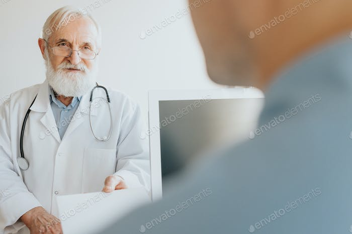 Senior physician talking to nure