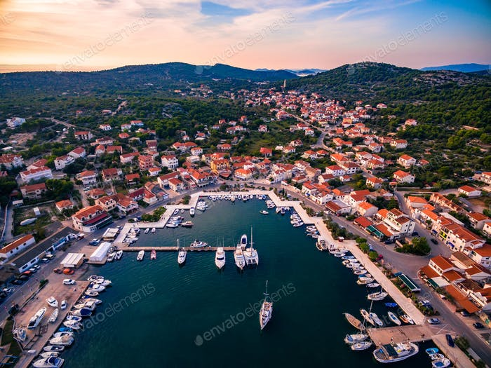 Aerial drone view of small marina with boats and yachts docked in Croatia