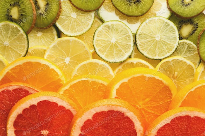 Rainbow background with exotic fruits