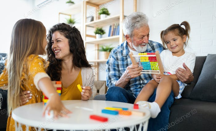 Happy family having fun time at home. Grandparent playing with children