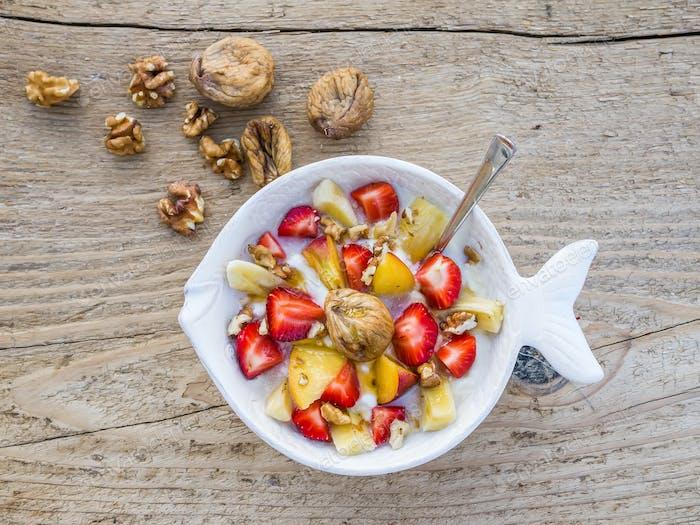 A bawl of fruit, walnuts and yogurt