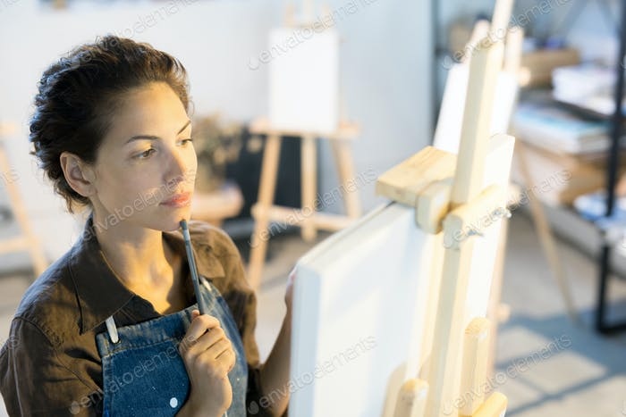 Woman in front of easel