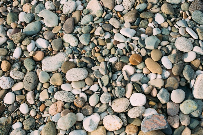 Old Pebble Stones Natural Background. Top View Of Multicolored S