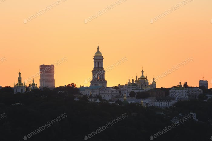 Kyiv pechersk lavra with golden cupola at sunset