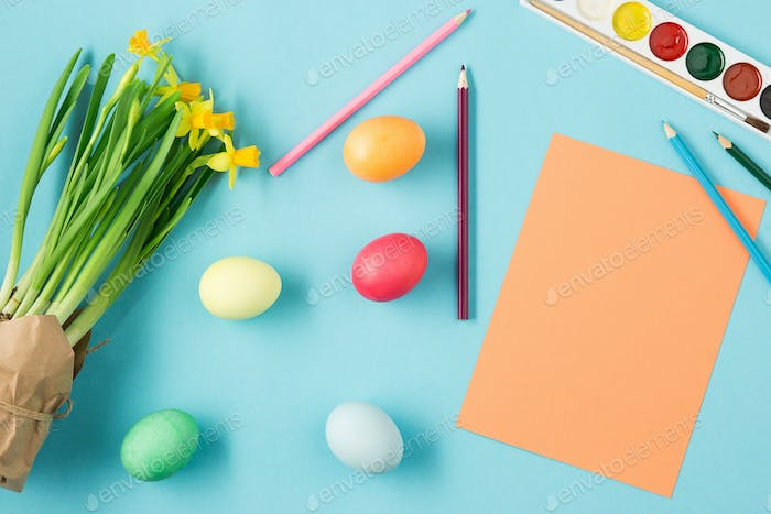 The top view of easter on blue table office workplace