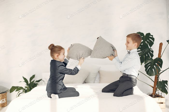 Children at home fight pillows