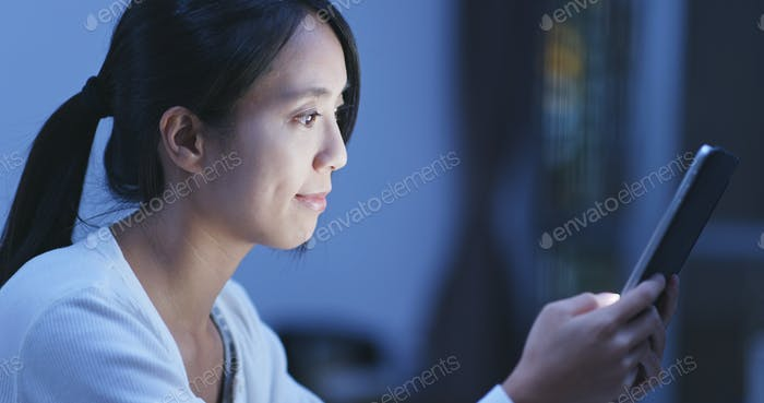 Woman watch on tablet computer at home