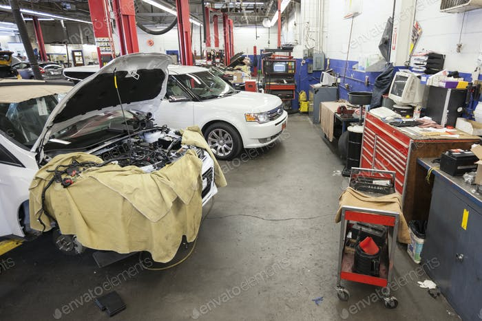 Cars and machinery in an auto repair shop.