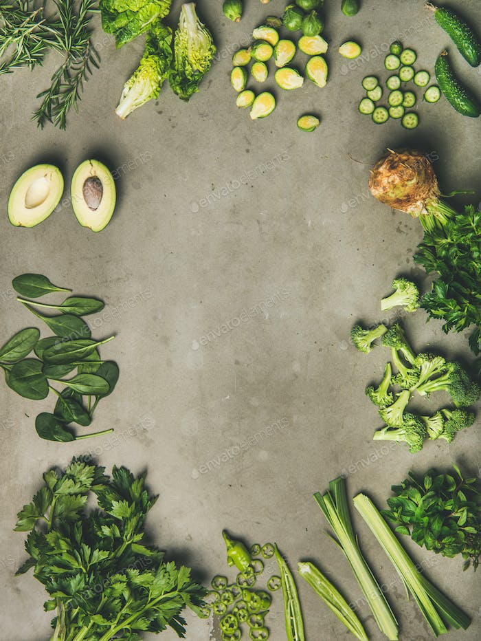 Flat-lay of whole and cut vegetables and herbs, copy space