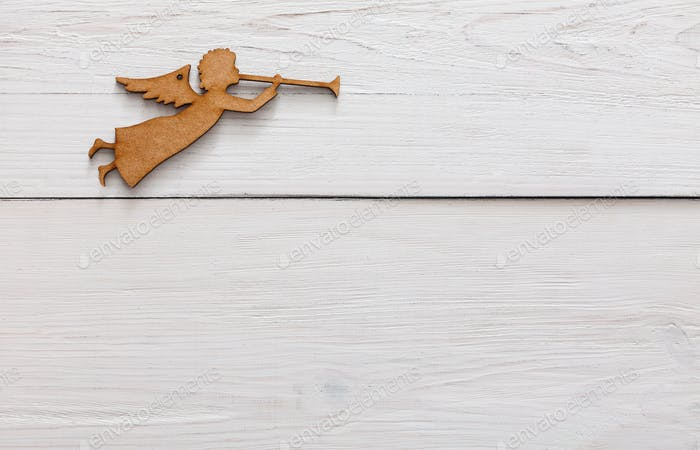 Christmas decoration angel on white wood background