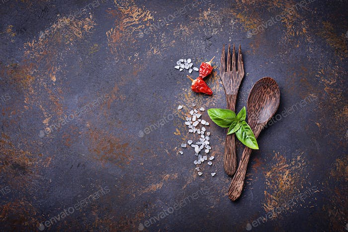 Fork and spoon with herbs and spices.
