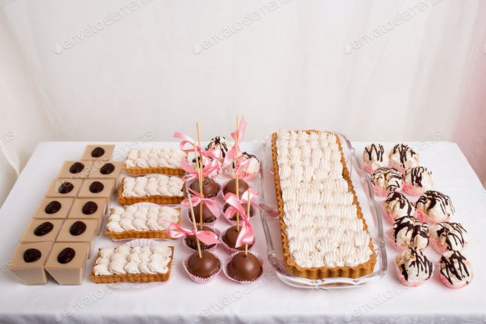 Mix of delicious french desserts on table.
