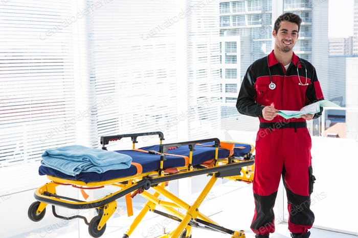 Portrait of handsome paramedic with medical report
