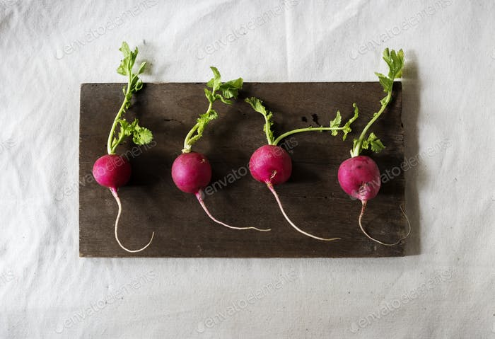 Closeup of fresh radish on wooden background