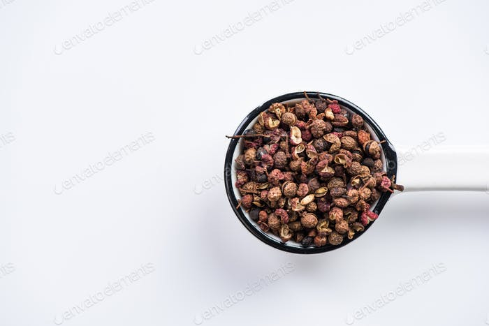 Sichuan pepper or Chinese coriander on spoon