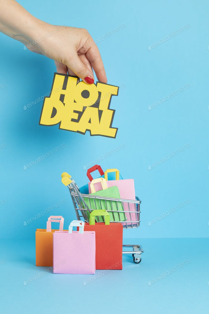 Shopping basket full of paper bags. Sesonal sale, online deals, discounts, promotions idea
