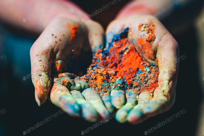 Holi powder held in woman's hand. Close-up.