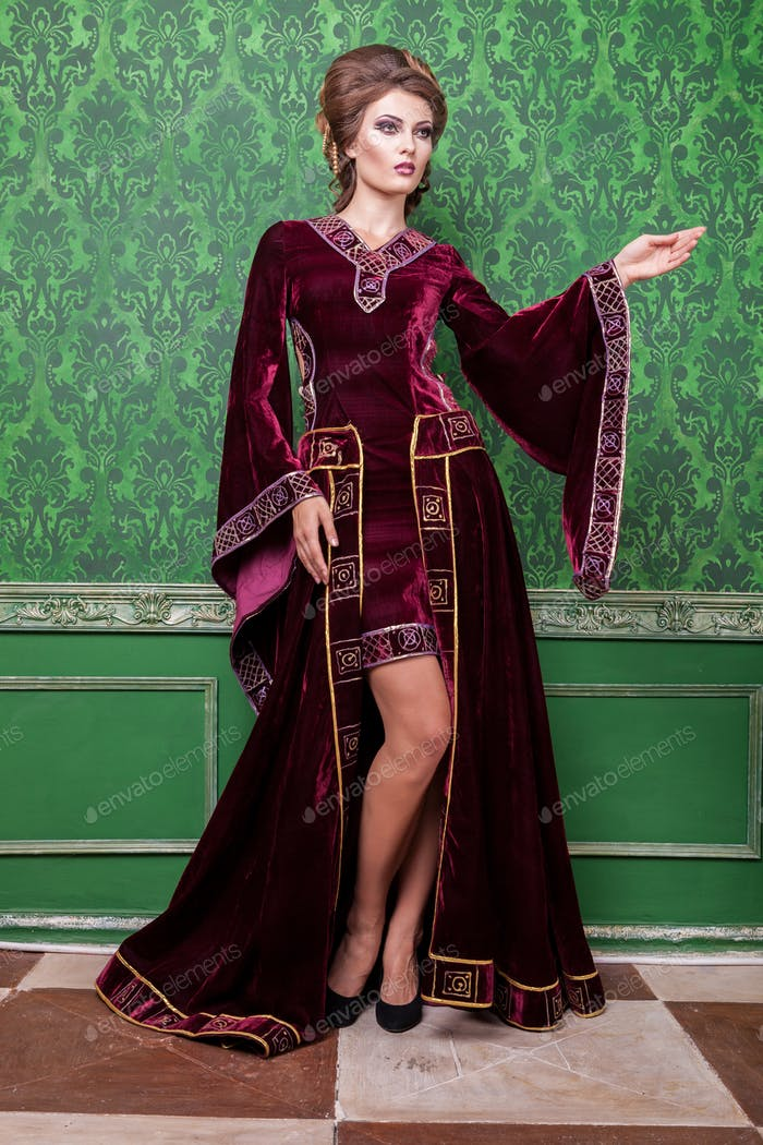 Gorgeous woman dressed in luxury retro clothes in vintage interi