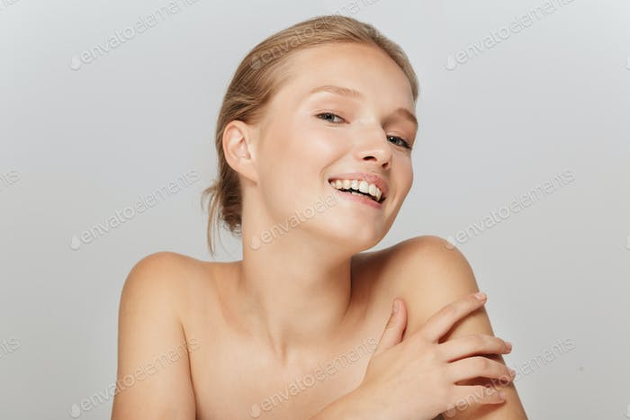 Portrait of young pretty smiling woman without makeup happily lo