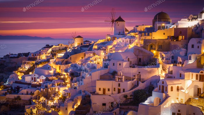 Dramatic Sunset in Mediterranean Town of Oia, Santorini, Greece,