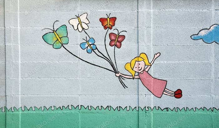 Blond girl floating with butterflies on a string