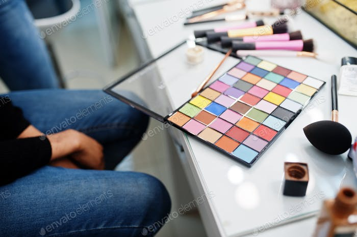 African American woman applying make-up