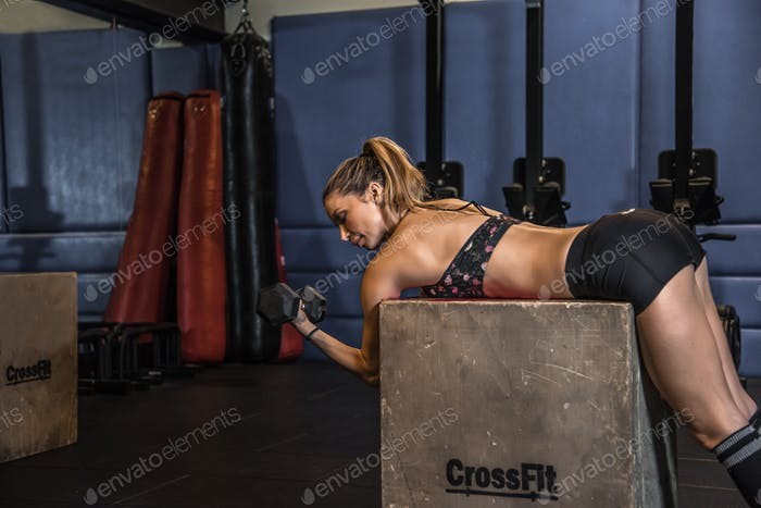beautiful blonde woman in the gym training crossfit