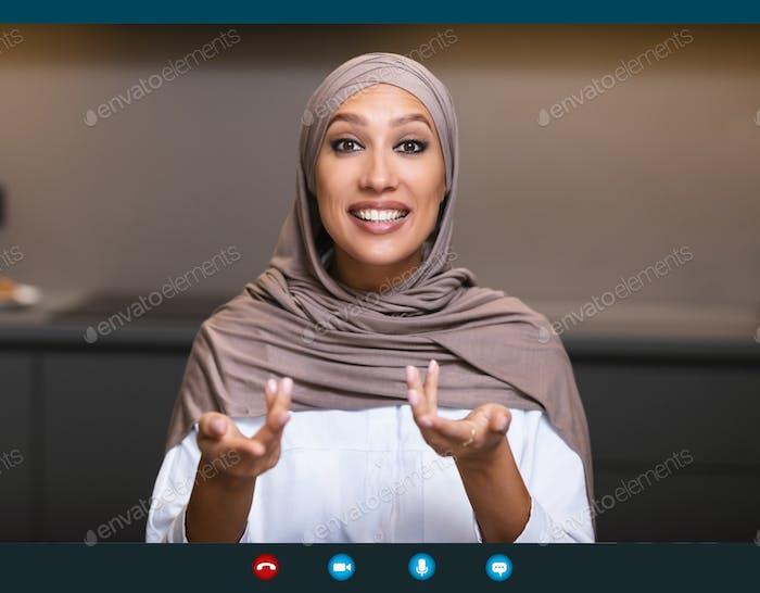 Arab Lady Talking Having Distant Meeting Via Video Call Indoors