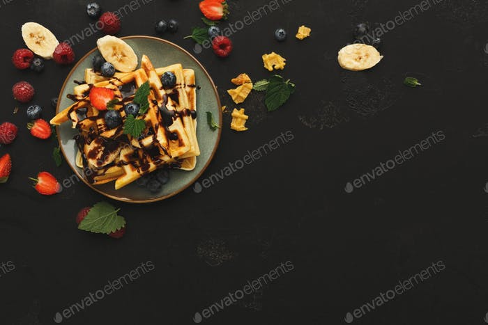 Belgian waffles with berries and fruits copy space