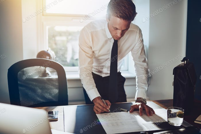 Business man standing at desk