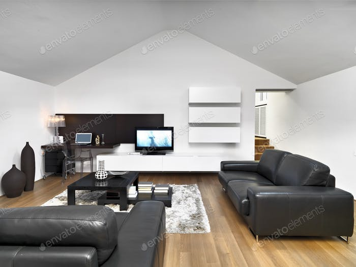 Interiors of a Modern Living Room in the Attic Room