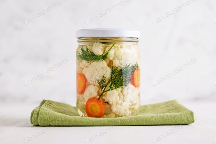 Jar with pickled vegetables