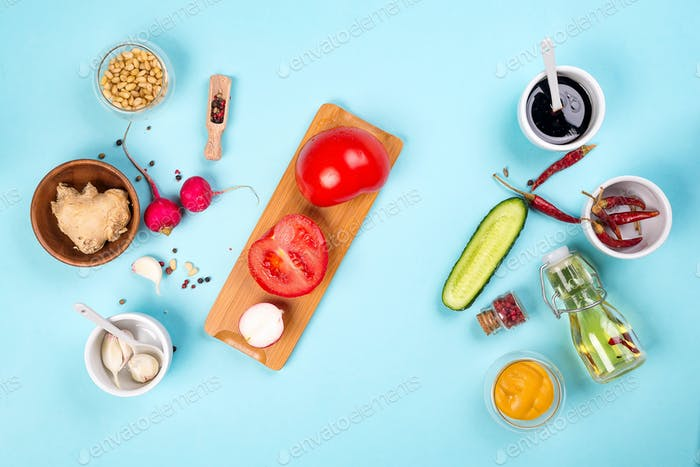 Homemade sauce or salad dressing in bowl with ingredients: fresh herbs, oil, lemon and honey