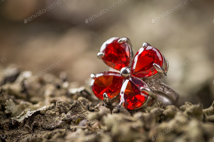 Ring with red gemstone