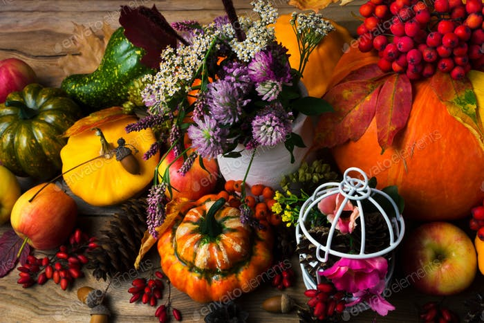 Fall decor with birdcage, apples and flowers
