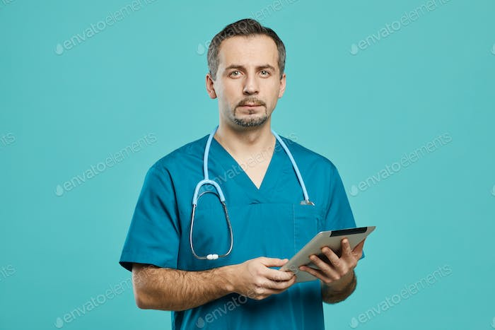 Surgeon using digital tablet at work