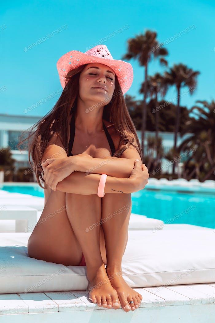 Nice female tanning on the beach