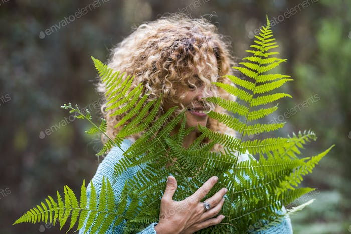 Embracing outdoors concept and love nature with portrait of beautiful young adult woman