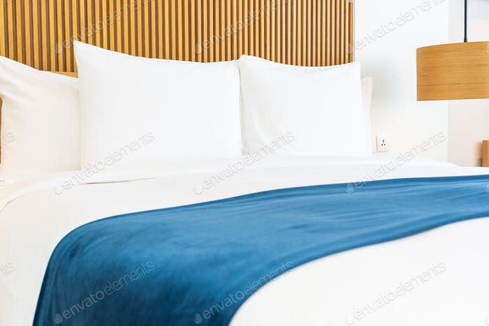 Beautiful comfortable pillow on bed decoration in bedroom