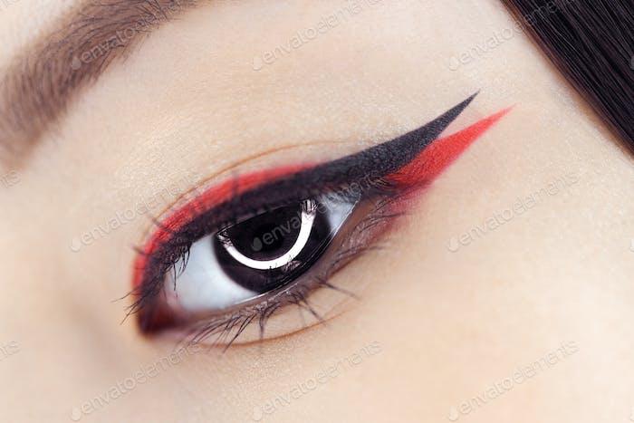 Creative fantasy eye makeup macro shot