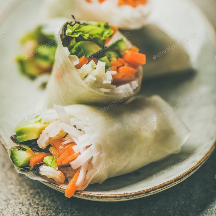 Shrimp and vegetable rice paper rolls on plate, square crop